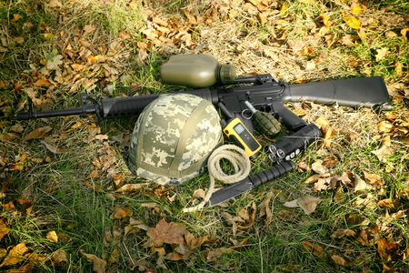 Military set on grass background Imagens