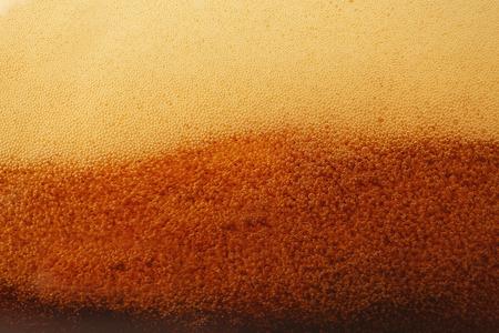 Dark beer bubbles closeup Stock Photo