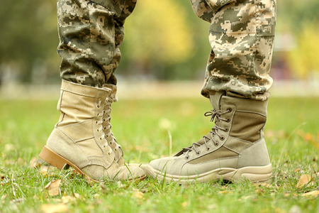 Military couple on sunny day in park, closeup