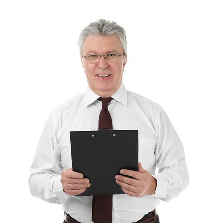 Senior businessman with clipboard on white background