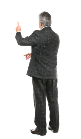 Senior businessman standing back on white background Foto de archivo