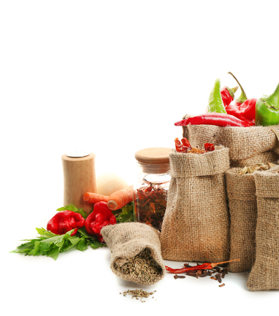 Spices in sacking bags on white background Standard-Bild - 108266646