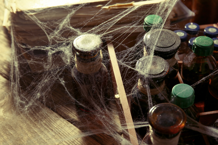 Vintage glass bottles with spiderweb, closeup 写真素材