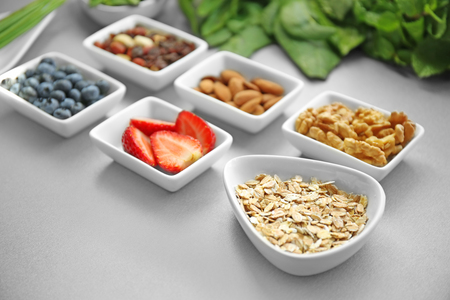 Healthy eating concept. Assortment of products in bowls on table, closeup