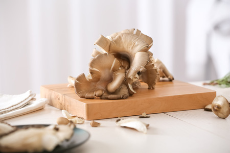 Fresh mushrooms on wooden cutting board