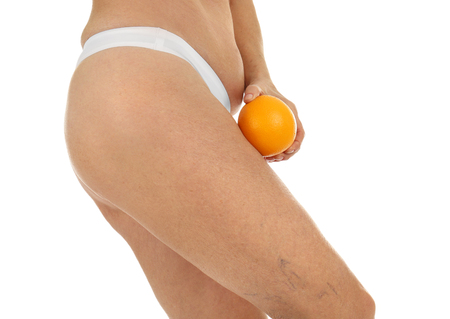 Senior woman body with orange on white background, closeup