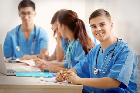 Group of medical students having lecture indoors Stockfoto