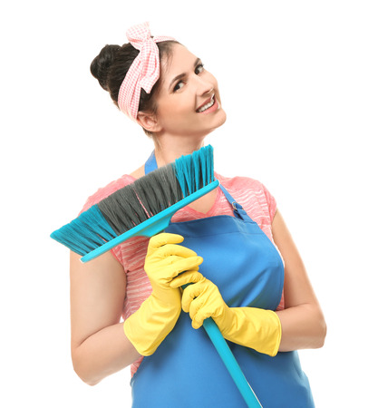 Young cleaner with brush on white background