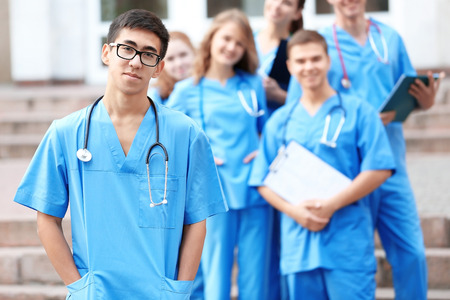 Young student with groupmates outdoors Stock Photo