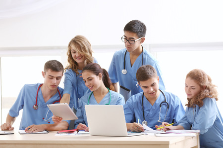 Group of medical students having lecture indoors Stock Photo