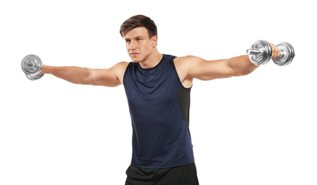 Young handsome sportsman doing exercises on white background 스톡 콘텐츠