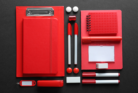 Flat lay of red stationery on black background Stok Fotoğraf - 108543811