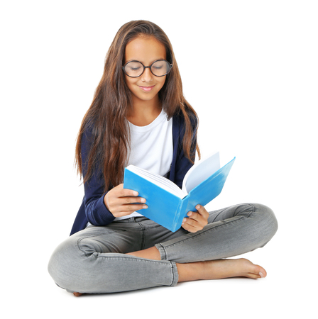 Cute girl reading book on white background
