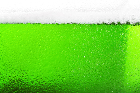 Close up view of glass with green beer. Saint Patricks Day concept