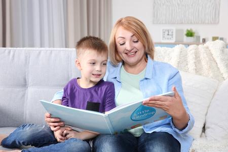 Grandmother reading her grandson book