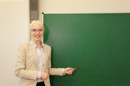 Beautiful school teacher in the classroom