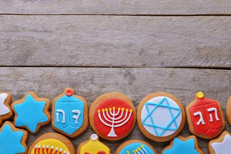 Tasty glazed cookies for Hanukkah on wooden table Stock Photo