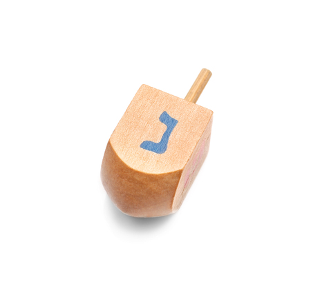 Wooden dreidel for Hanukkah on white background Archivio Fotografico - 108416109