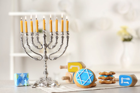 Beautiful composition for Hanukkah on grey table against blurred background