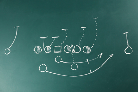 Scheme of American football game on blackboard background