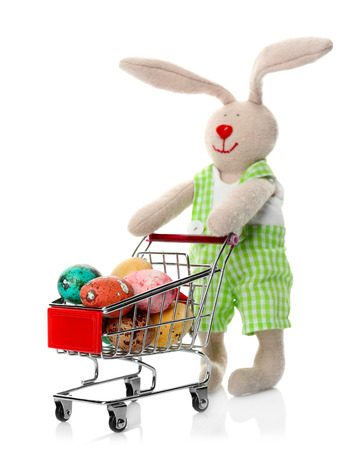 Easter bunny with eggs in shopping cart on white background Banco de Imagens