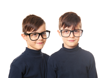 Twin brothers in glasses on white background