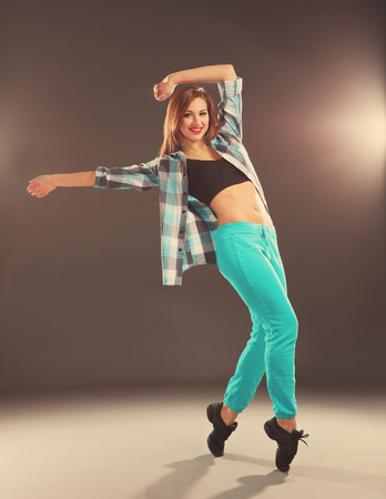 Hip hop dancer on dark background