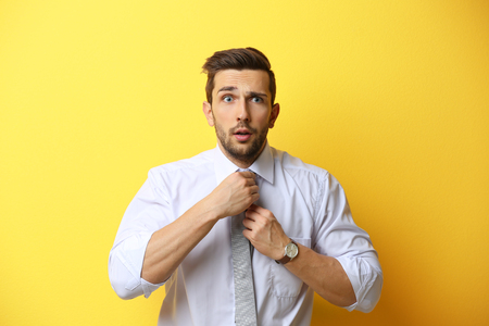 Young man posing on yellow background