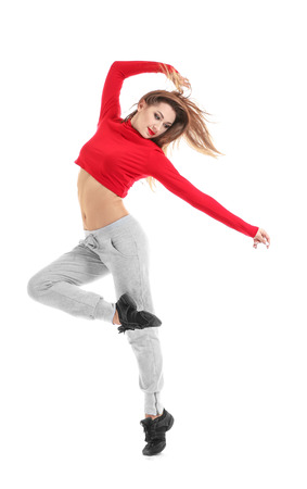 Hip hop dancer dancing on white background Stock Photo