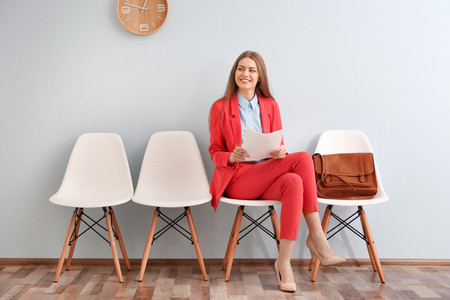 Young woman waiting for interview indoors
