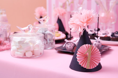 Birthday hat on table prepared for party