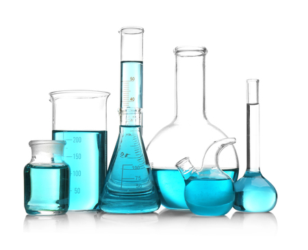 Laboratory glassware with blue samples on white background