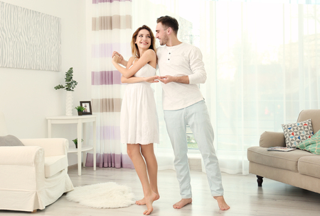Cute young couple dancing at home Banco de Imagens
