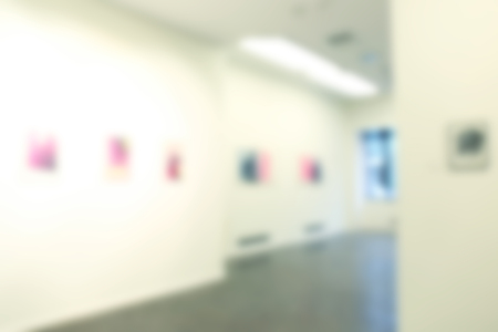 Blurred view of empty art gallery with pictures Banco de Imagens