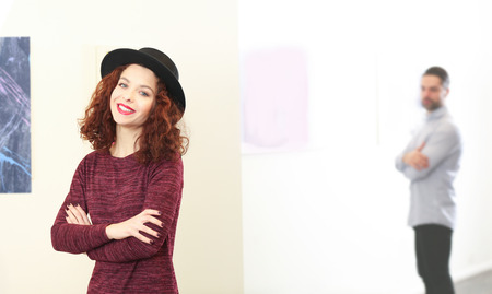 Young woman in modern art gallery Banco de Imagens