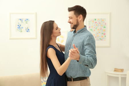 Young couple dancing in the room Stock Photo