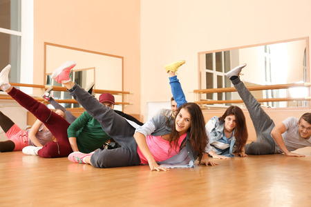 Group of young hip-hop dancers in studio