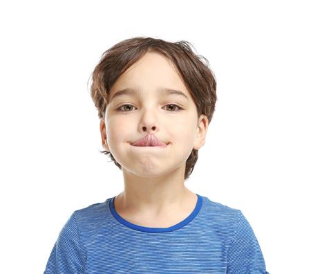 Little boy training pronounce letters    on white background Фото со стока