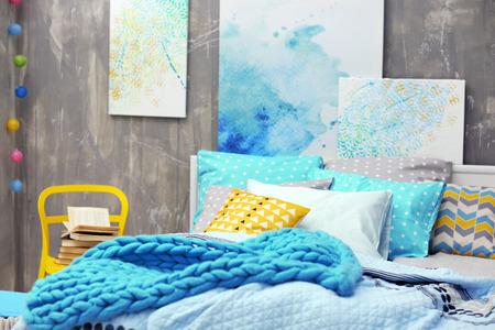 Interior of modern bedroom with cozy double bed Archivio Fotografico
