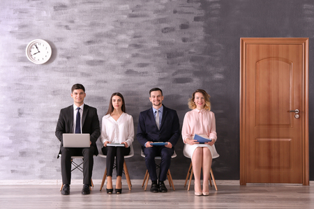 Group of people waiting for job interview in reception hall