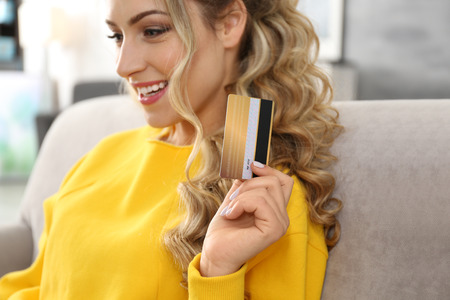 Young woman with credit card. Shopping online concept