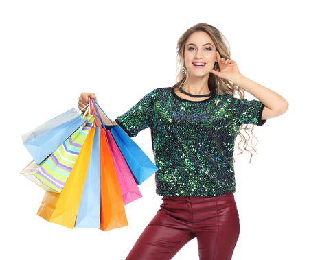 Woman with shopping bags on white background 写真素材