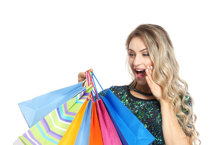 Woman with shopping bags on white background 스톡 콘텐츠