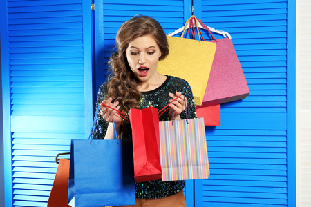 Young woman with shopping bags in dressing room 스톡 콘텐츠