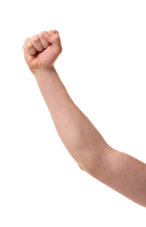 Raised male hand with clenched fist on white background Фото со стока
