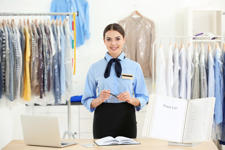 Female worker in dry-cleaning salon Stock Photo