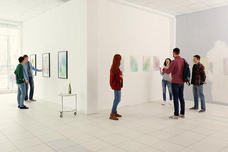 Young people in modern art gallery hall Banco de Imagens