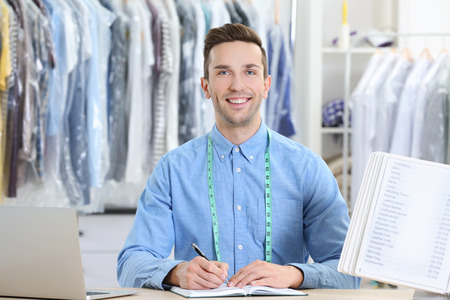 Male worker in dry-cleaning salon Stock Photo