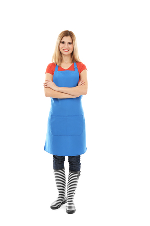 Beautiful woman in blue apron isolated on white background 版權商用圖片
