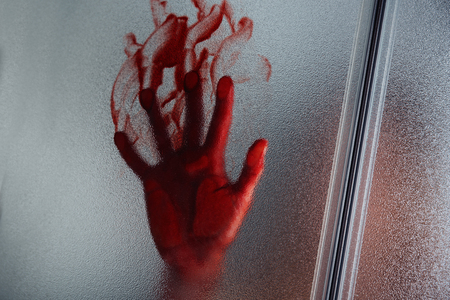 Bloody hand of depressed woman in shower